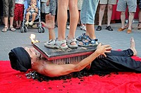 Bed of nails, fakir, trick, display, medieval market, medieval games, La Nucia, Costa Blanca, Alicante, Spain, Europe