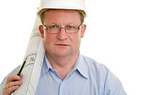 Portrait of a site manager wearing a helmet, holding a blueprint and a pencil