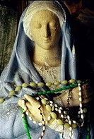 Statue of the Virgin Mary, decorated with brightly coloured rosary beads, detail, chapel in County Kilkenny, Ireland, Europe