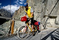 Mountainbiker crossing a wooden bridge, Gilgit, Karakorum Highway, Northern Areas, Pakistan, Asia
