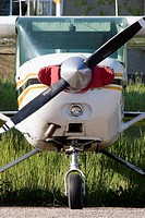 Cessna light aircraft trainer front view propeller and landing gear at airstrip in Alberta. Canada