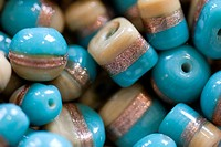 Multi shaped glass beads, blue copper cream, close-up