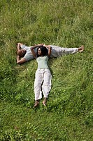 African couple relaxing in grass