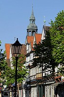 Half-timbered houses, Zoellnerstrasse with the parish church tower in the background, Celle, Lower Saxony, Germany, Europe