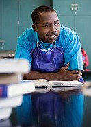 African teenage boy studying in chemistry lab