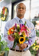 African man holding bouquet of fresh flowers