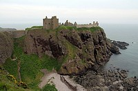 Dunnottar Castle, castle ruins in front of the panoramic view of the coastal cliffs of Stonehaven near Aberdeen, Scotland, United Kingdom, Europe