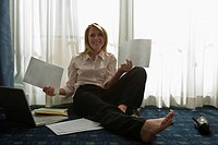 Businesswoman on bed with paper documents