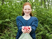 Portrait of a girl holding an apple