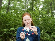 A girl holding a dna model
