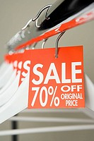 Sale labels on clothes hangers