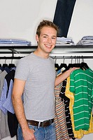Young man in a clothes store