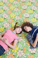 Boy and girl on floral pattern