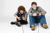 Teenager boys playing video game (thumbnail)