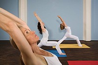 Three women practising yoga