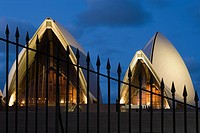 Sydney opera house and a fence at night
