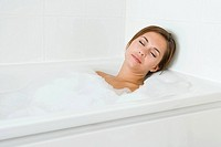 Woman sleeping in bath