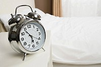 Alarm clock by bed