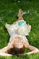 Woman sleeping on grass (thumbnail)