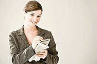 A woman writing on a financial paper