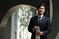 Japanese businessman holding a newspaper