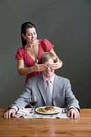 A woman surprising a man with a meal