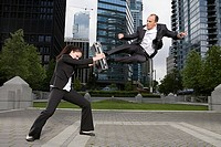 Businesspeople practising capoeira