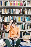 Confused student in library