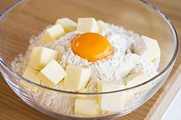 Flour egg and butter in a bowl