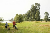 Couple in countryside with bicycles