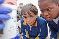 Glynn Roberts a volunteer with CH2MHILL helps students Logan Webb, left and Jeray Booker with their water analysis.  Hazelwood Southeast Middle School...