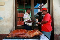 Delivery of a suckling pig in Trinidad, Sancti-Spíritus Province, Cuba, Latin America