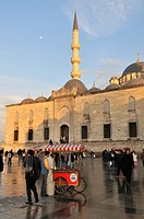 Roast chestnut street vendors in front of the Yeralti Camii Mosque, Istanbul, Turkey