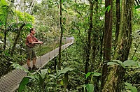 Man standing on a hanging bridge near Lake Arenal, Costa Rica, Central America