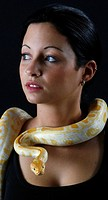 Young woman wearing a Corn Snake as necklace