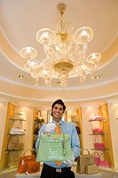 Salesman displaying purse