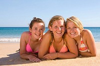 Teenage girls posing on beach