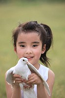 Chinese Girl Holding Pigeon,Beijing,China