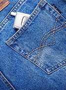 mobile phone in bag of jeans