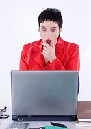 shocked business woman using laptop in office