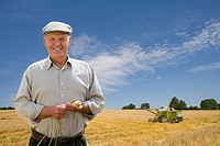 Portrait of farmer in barley field