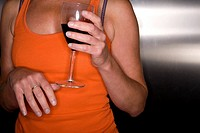 Close up of woman holding glass of red wine