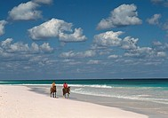 Woman and local guide going on horses, Pink Sand Beach, Harbour Island, Bahamas