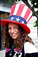 Teenage girl with Stars and Stripes hat, Philadelphia, Pennyslvannia, USA