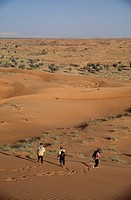 Tourists trekking through the desert, Nr Al_Ain, Abu Dhabi, UAE
