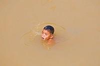 Boy swimming, Cambodia, Southeast Asia