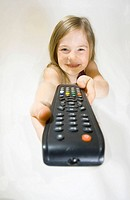 5_year_old girl holding up a tv remote control