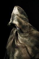 Hooded monk wearing cloak