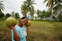 INDONESIA  CRS housing project at Seunebok Tuengoh relocation site  Woman with coconuts  Meulaboh, Aceh, two years after the Tsunami