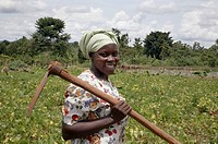 UGANDA  Nejjemba Teopista, farmer of Kayunga and farmer´s group animator, holding her hoe after working in a communal garden at Kangulumira where food...
